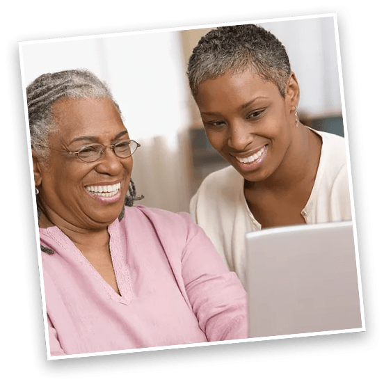 African American women smiling on laptop