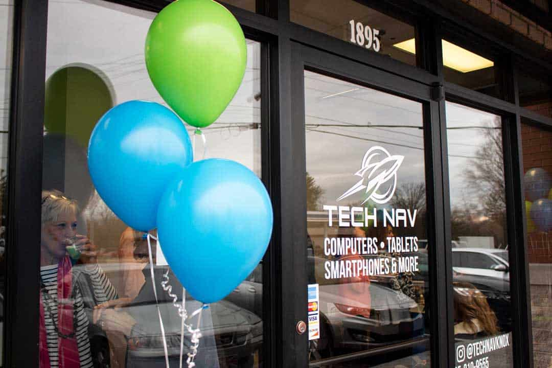 Tech Nav front door with logo and bright balloons